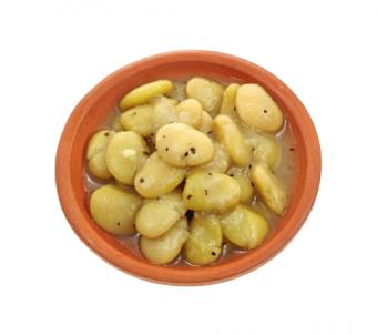 Cooked lima beans sprinkled with cracked pepper