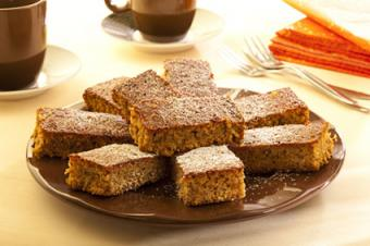 Gingerbread cake with powdered sugar topping.