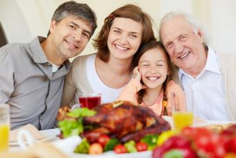 Happy family at Thanksgiving; © Dmitriy Shironosov | Dreamstime.com
