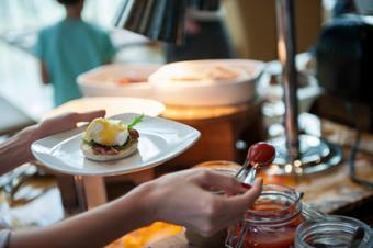 Woman serving herself brunch