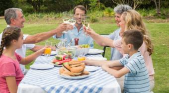 Family toasting at dinner outside