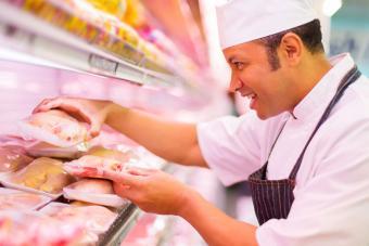 Butcher inspecting chicken