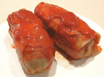 Cabbage rolls covered in tomato sauce