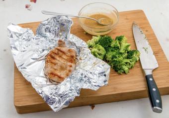 Foil-grilled pork chop and fresh broccoli