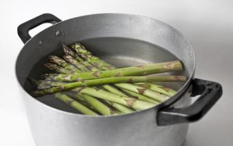 boiling asparagus in a large pot