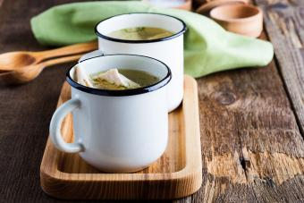Homemade turkey soup in white mugs