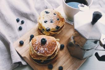stack of blueberry pancakes with coffee