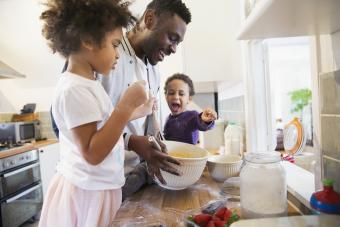 Father cooking with children
