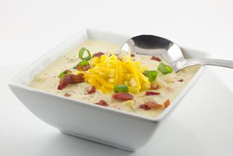 Corn chowder with scallions bacon and grated cheddar cheese