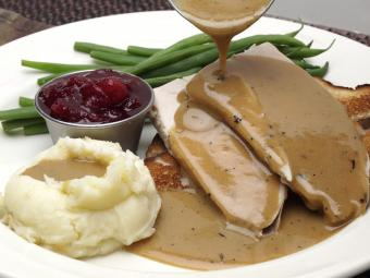 Turkey with gravy, mashed potatoes and green beans