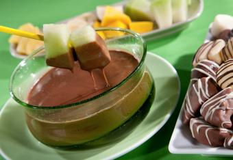 Fresh Fruit Being Dipped In Chocolate