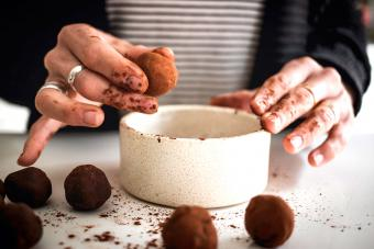 Person rolling truffles in chocolate