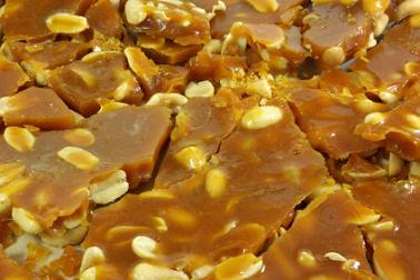 Freshly broken peanut brittle