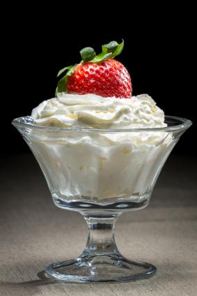 whipped cream with strawberry on top
