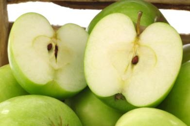Granny Smith apples sliced open