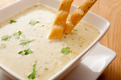 Cream of celery soup with bread sticks