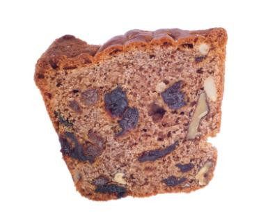 Slice of walnut raisin cake