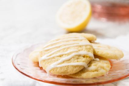 Plate filled with glazed lemon cookies