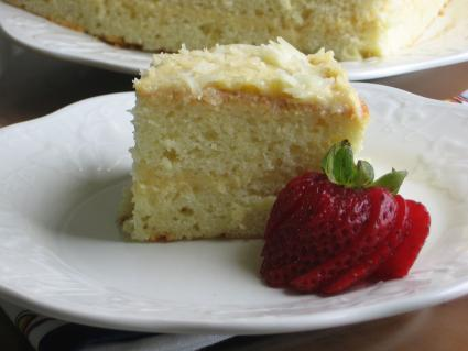 Image of a piece of yema cake with strawberry slices