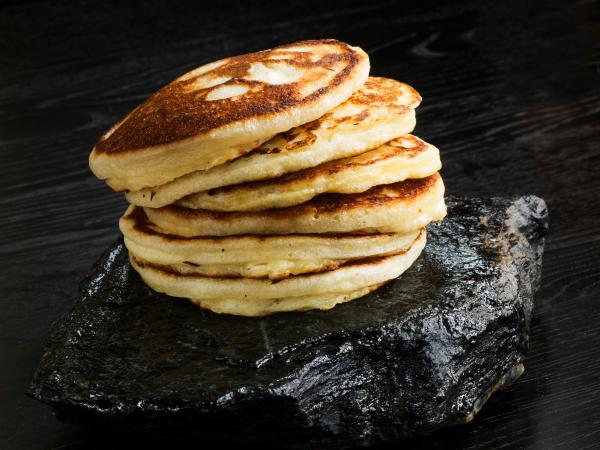 Pancakes stacked on black stone