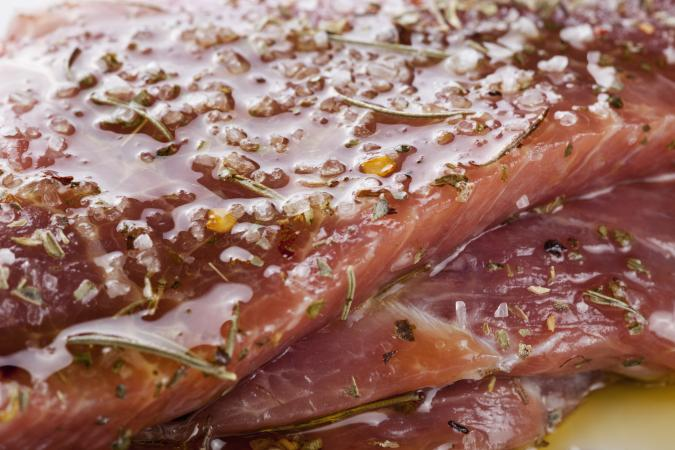 Closeup of pork with wet seasonings