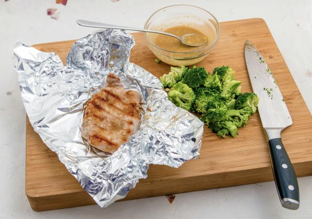 Foil-grilled pork chop and fresh broccoli