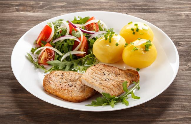 Baked pork chop dinner with veggies