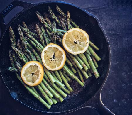 Asparagus and lemon in skillet
