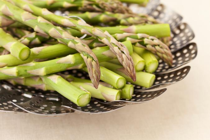 asparagus in a steamer basket