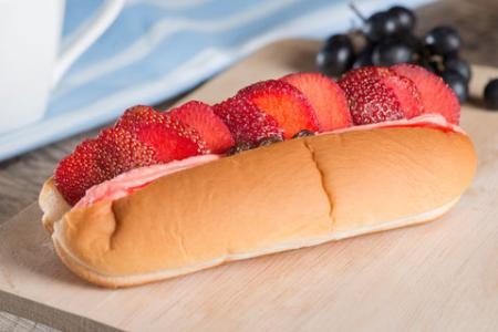 Hot dog bun with strawberry slices