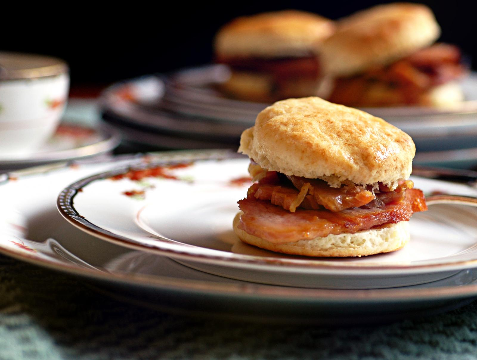 Fresh buttermilk biscuits with country ham on plates