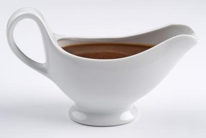 White china gravy boat with gourmet gravy