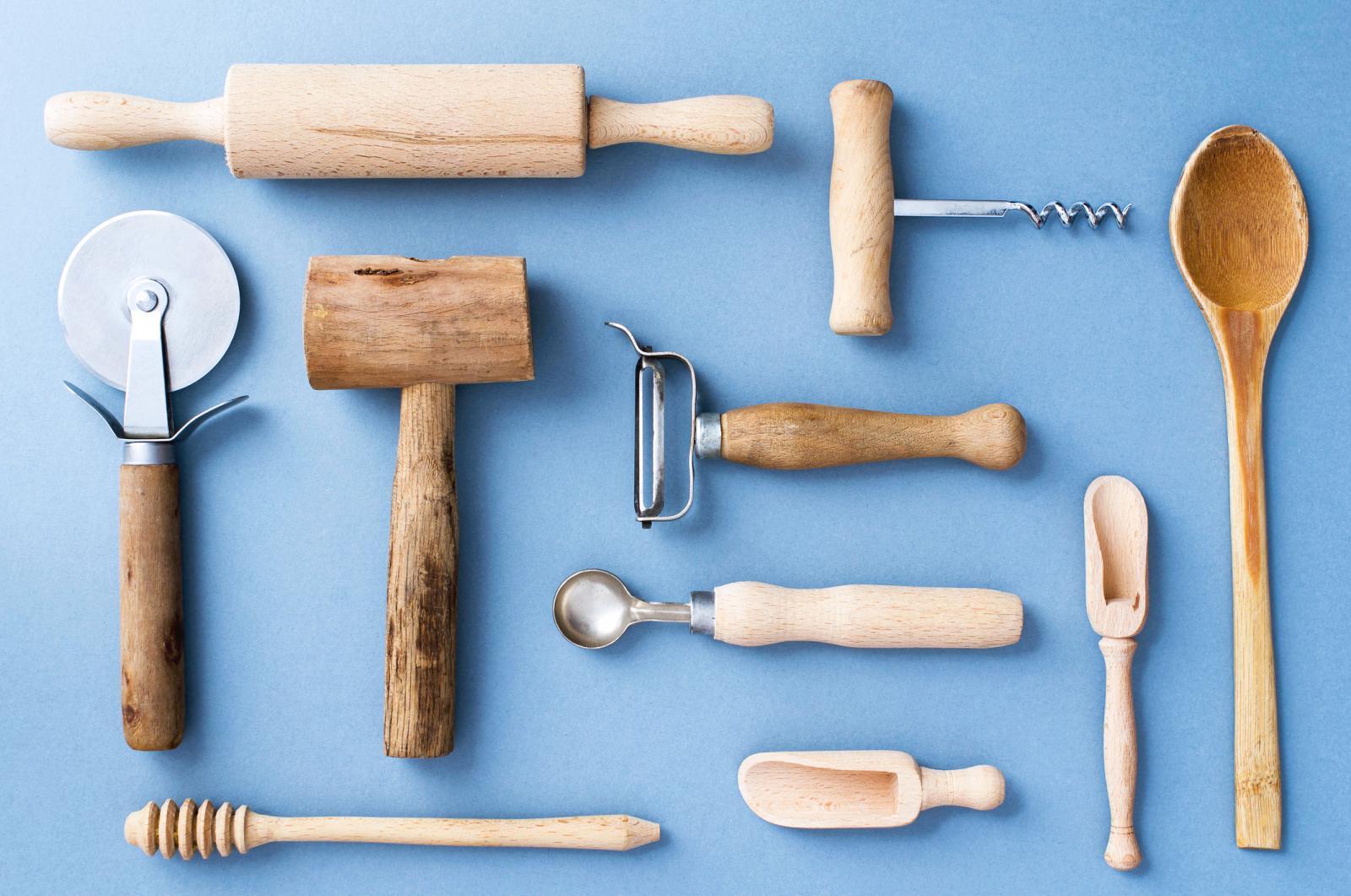 Wooden Kitchen Utensils On Blue Background