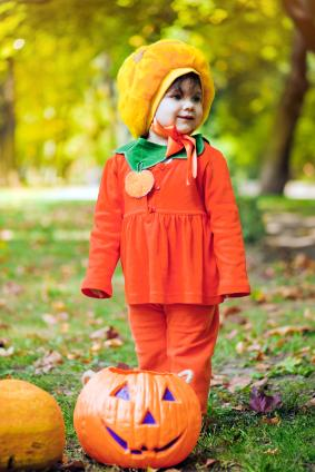 toddler girl in pumpkin outfit