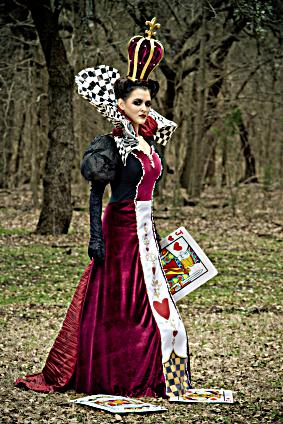 Woman wearing a Queen of Hearts costume