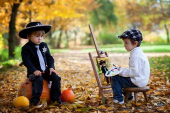 Toddler boys in Halloween costumes