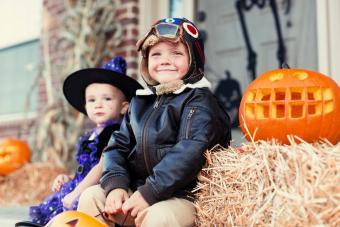 Little boy smiling in pilot costume