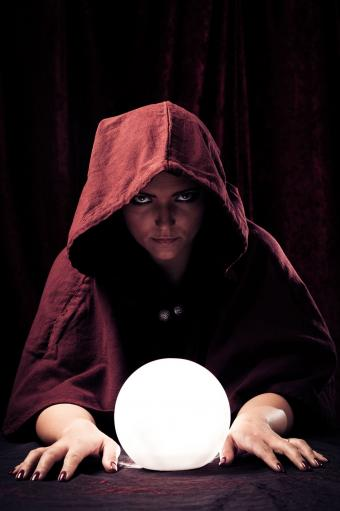 Fortune teller with lit crystal ball