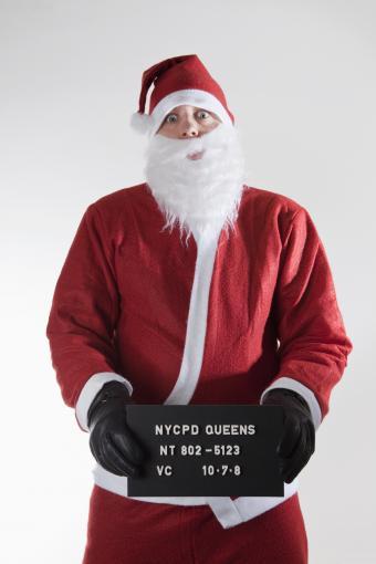 https://cf.ltkcdn.net/costumes/images/slide/247438-567x850-santa-mug-shot-costume.jpg