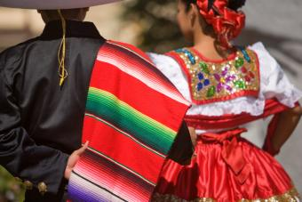 Mexican performers man wearing serape