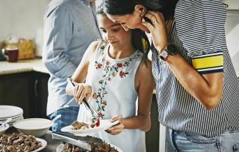Girl wearing embroidered dress at a family dinner party