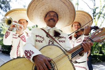 Musicians playing in mariachi band wearing Charro suits