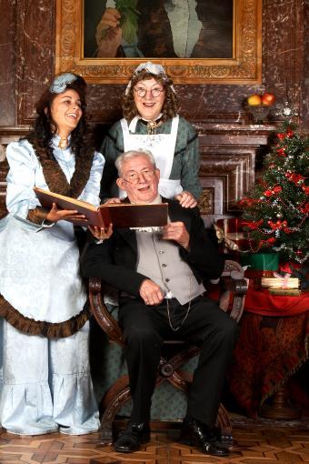 Vintage christmas scene of a victorian family singing christmas carols