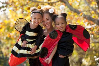 Mother and daughters in Halloween costumes Get Buggy With It