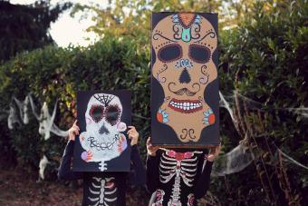 Two children in Halloween costumes Day of the Dead