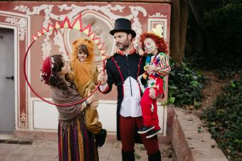 Family of four dressed as the circus playing