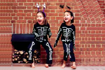 Halloween Girls In Skeleton Outfits