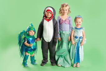 Portrait of children in Mermaid and fish costumes for Halloween