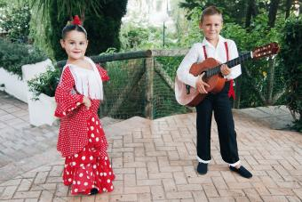 Girl and boy in traditional flamenco costumes
