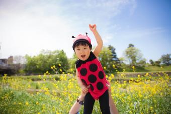 girl flying in ladybird clothing